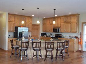pole-barn-houses-with-kitchen-design-and-swivel-bar-stools-also-kitchen-cabinet-with-pendant-lighting-and-tile-backsplash-plus-hardwood-flooring-and-building-a-pole-barn-with-morton-building-prices.jpg